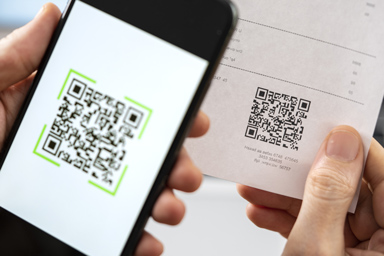 A person scans a QR code on his smartphone.
