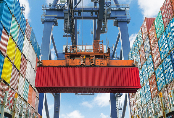 A crane moves containers in a port