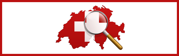 Magnifying glass resting on a map of Switzerland decorated with the Swiss flag